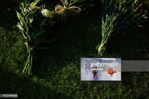 Hand-drawn messages for the queen are seen among the flowers, as tributes continue to be made to Prince Philip, the Duke Of Edinburgh who died at age...