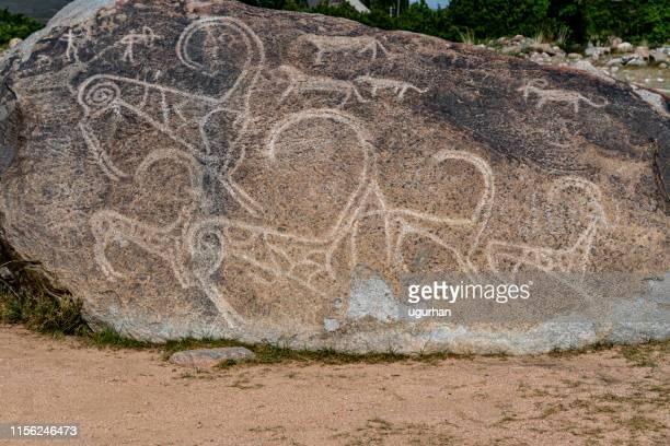 hand-drawn rocks (petroglyphs) in cholpon-ata city, kyrgyzstan - kyrgyzstan stock pictures, royalty-free photos & images