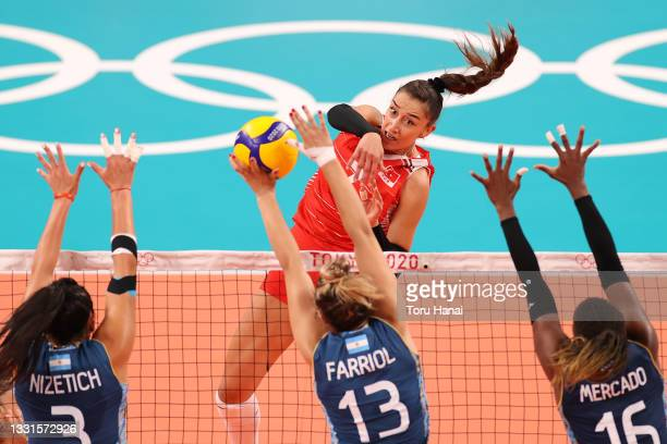 Hande Baladin of Team Turkey hits against Team Argentina during the Women's Preliminary - Pool B volleyball on day eight of the Tokyo 2020 Olympic...