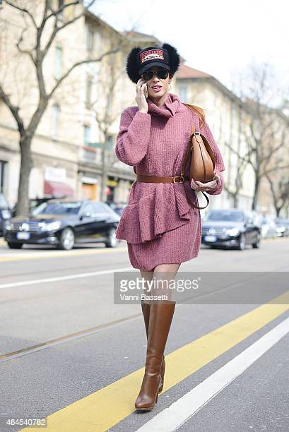 Hande Can Yuce wears H and M dress Louboutin boots Dsquared hat and Celine bag on February 26 2015 in Milan Italy