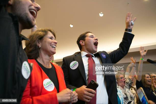 Handel supporters including Amy Kaye and Adam Kaye cheer for early results in favor of Georgia's 6th Congressional district Republican candidate...