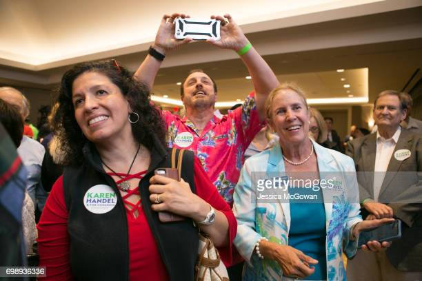 Handel supporters including Rebecca Prendes Dr Tony Prendes and Sue Marshall cheer for early results in favor of Georgia's 6th Congressional district...