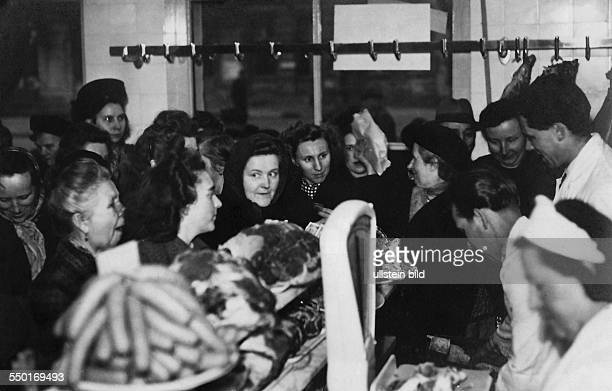 Handelsorganisation setting up national retail business in the Soviet Zone of occupation in Germany crowded meat shop/butcher in East Berlin