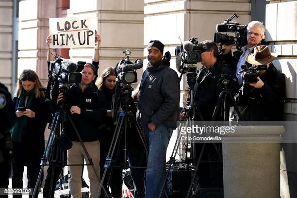 A handful of demonstrators held signs as they joined journalists outside the Prettyman Federal Courthouse where Michael Flynn former national...