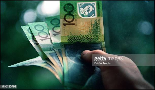 A handful of hundred dollar bills 4 April 2002 AFR GENERIC Picture by LOUISE KENNERLEY