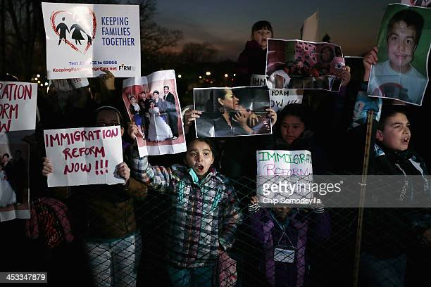 A handful of immigration reform proponents demonstrate during the US Capitol Christmas Tree lighting ceremony on the West Front December 3 2013 in...