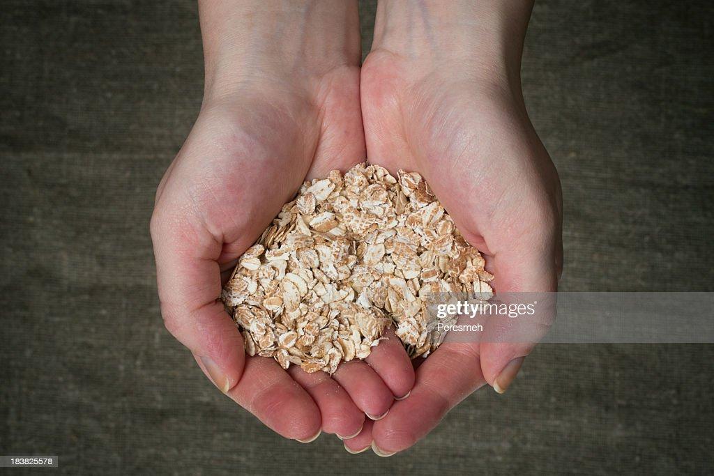 Handful of oat flake : Stock Photo