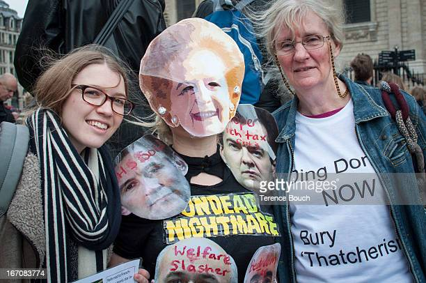 CONTENT] A handful of protestors outside St Paul's Cathedral show their opposition to the ceremonial funeral of Lady Thatcher with one lady wearing a...