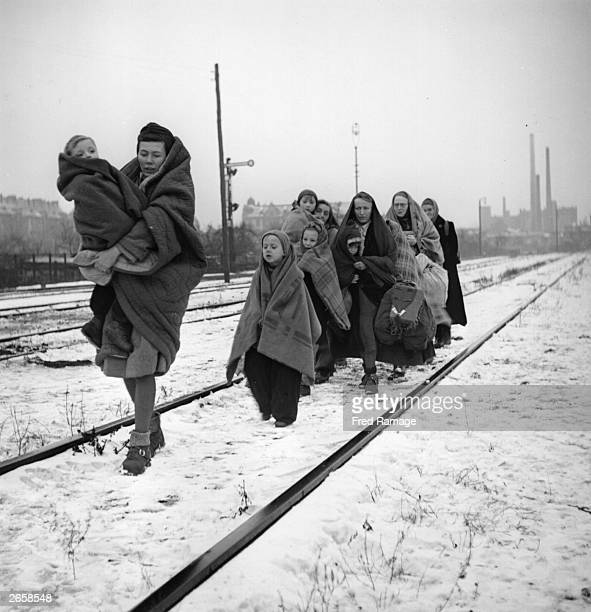 Handful of survivors from the 150 refugees who left Lodz in Poland two months earlier headed for Berlin. They are following railway lines on the...