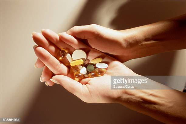 handful of vitamins - nutritional supplement stock pictures, royalty-free photos & images