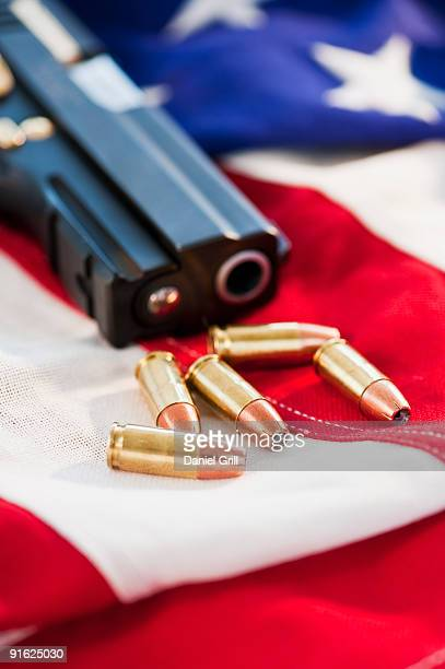 A handgun and ammunition on the American flag