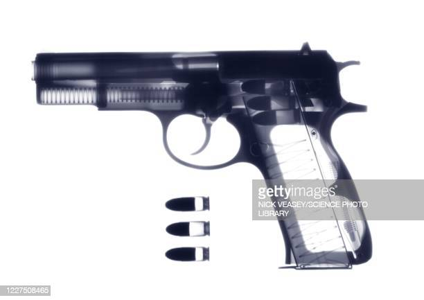 handgun and bullets, x-ray - gun stock pictures, royalty-free photos & images