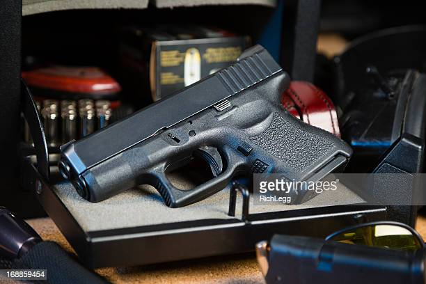 handgun and safe - weaponry stock pictures, royalty-free photos & images