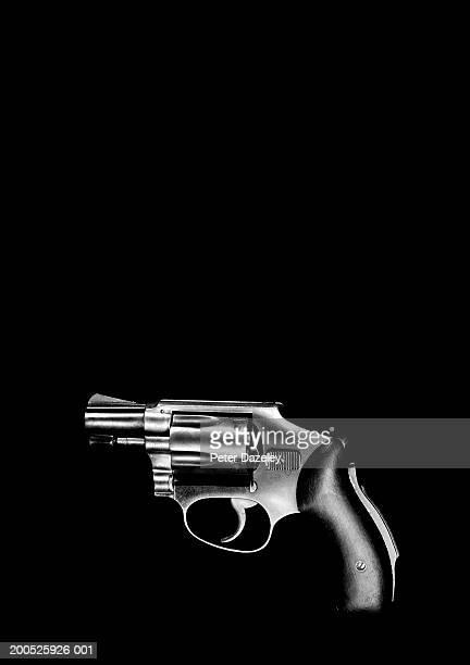 handgun, black background - pistol stock pictures, royalty-free photos & images