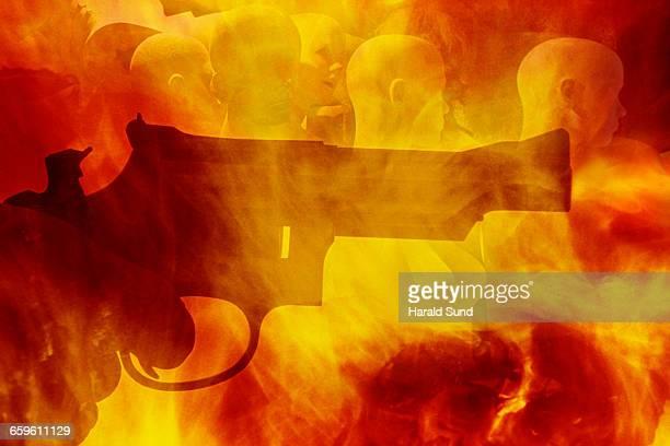 Handgun, fiery background, mannequin people.