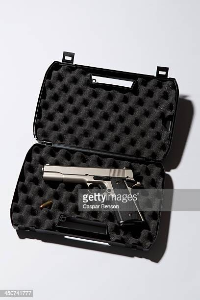 A handgun in a protected briefcase with a bullet