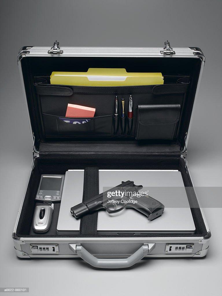 Handgun in Briefcase : Stock Photo