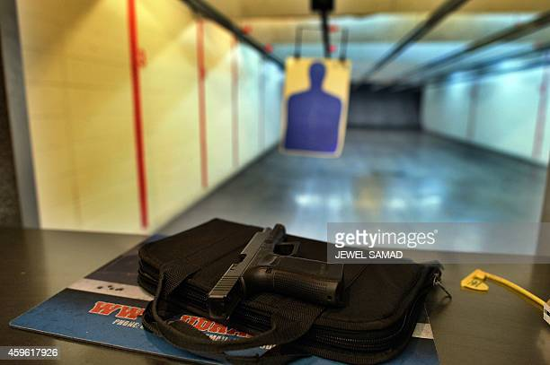A handgun is seen on a counter at the Ultimate Defense Firing Range and Training Center in St Peters Missouri some 20 miles west of Ferguson on...