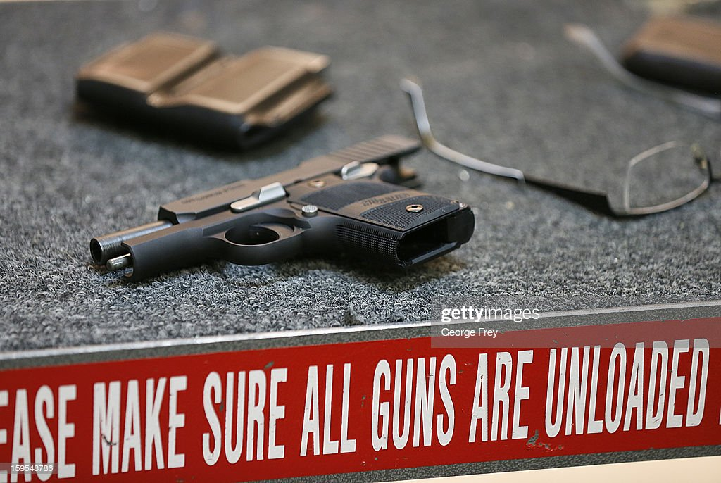 A handgun lays on a table after being fired at the 'Get Some Guns & Ammo' shooting range on January 15, 2013 in Salt Lake City, Utah. Lawmakers are calling for tougher gun legislation after recent mass shootings at an Aurora, Colorado movie theater and at Sandy Hook Elementary School in Newtown, Connecticut.