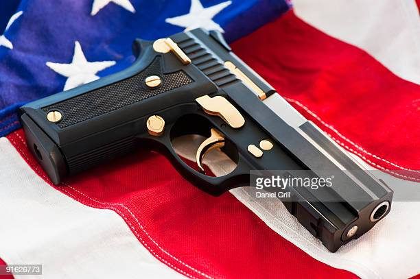 A handgun on the American flag