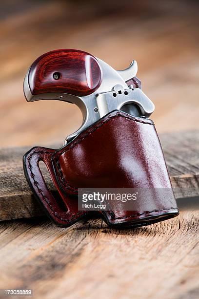 Handgun on Wood Background