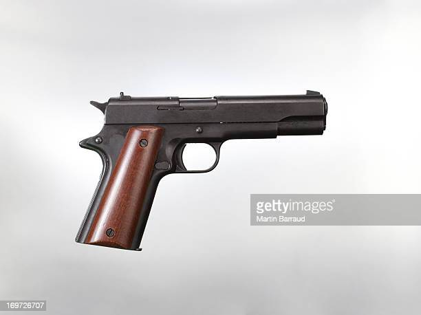 handgun - gun stock pictures, royalty-free photos & images