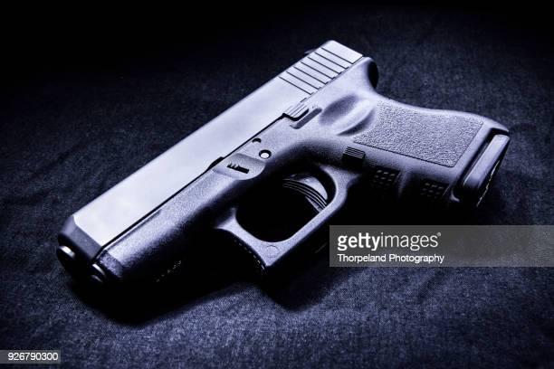 handgun - pistol stock pictures, royalty-free photos & images