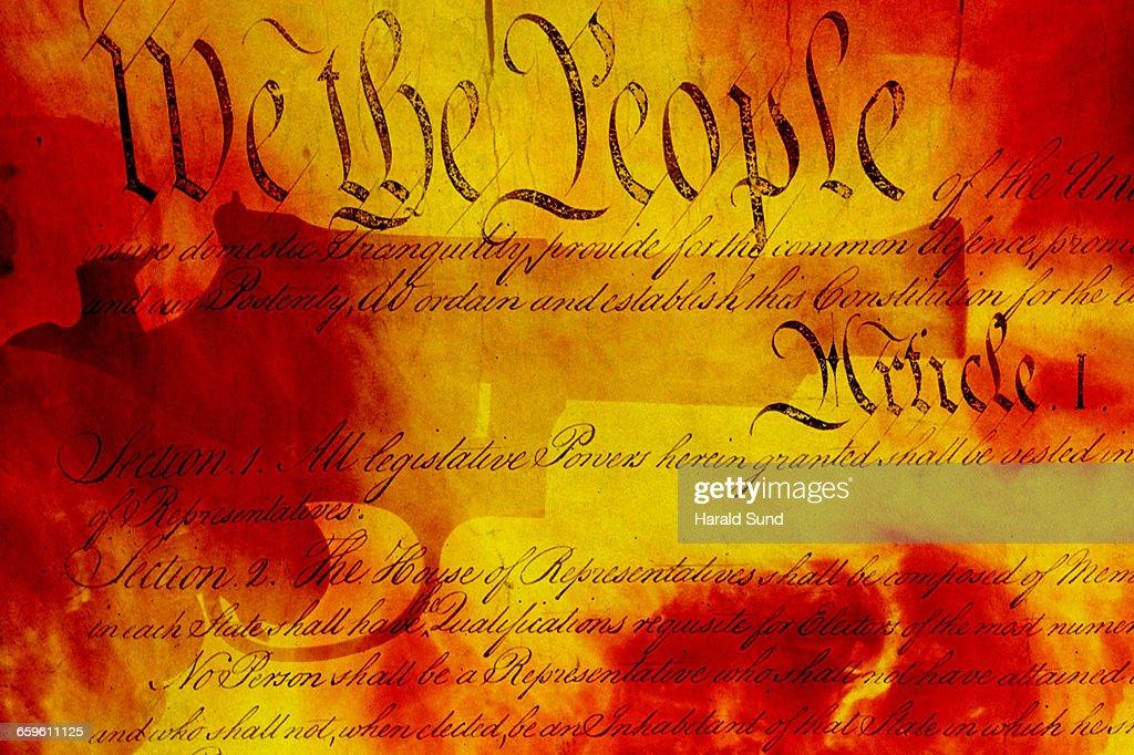 Handgun, USA Constitution, fiery background. : Stock Photo