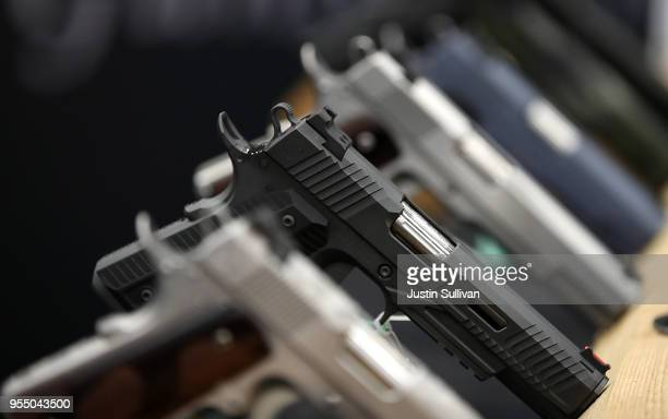 Handguns are displayed during the NRA Annual Meeting Exhibits at the Kay Bailey Hutchison Convention Center on May 5 2018 in Dallas Texas The...