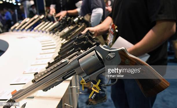 Handguns including the model 629 44 Magnum SW Special are displayed at the Smith Wesson booth at the 2016 National Shooting Sports Foundation's...