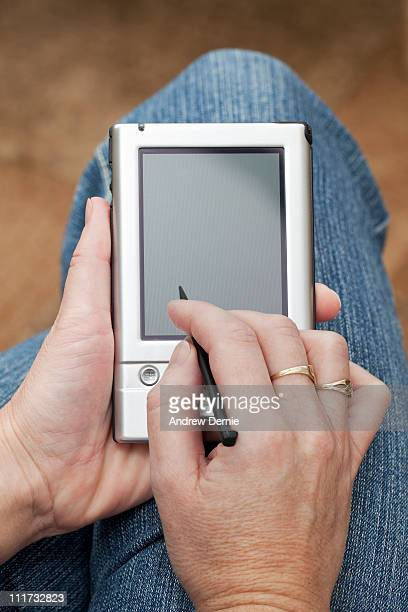 handheld computer - andrew dernie stock pictures, royalty-free photos & images