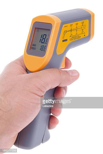 handheld infrared thermometer with digital display - infrared lamp stock photos and pictures