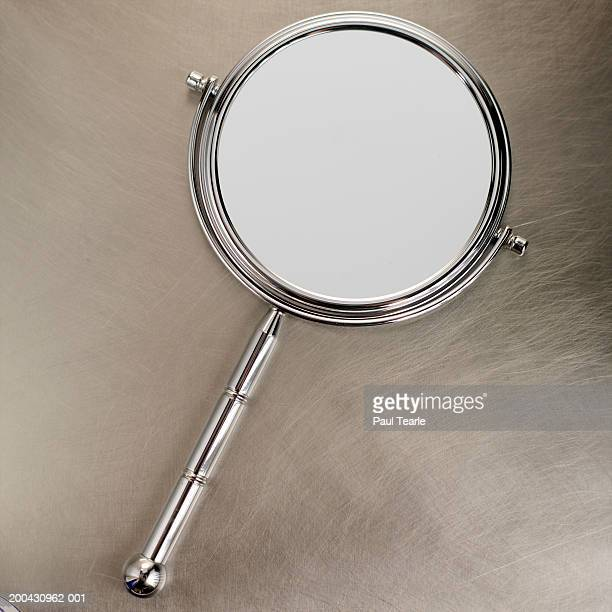 Hand-held mirror, close up