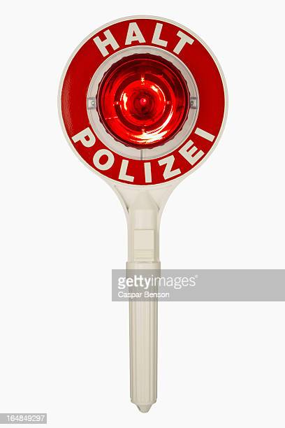 a handheld police traffic control sign with halt polizei, german for stop police - red light stock pictures, royalty-free photos & images