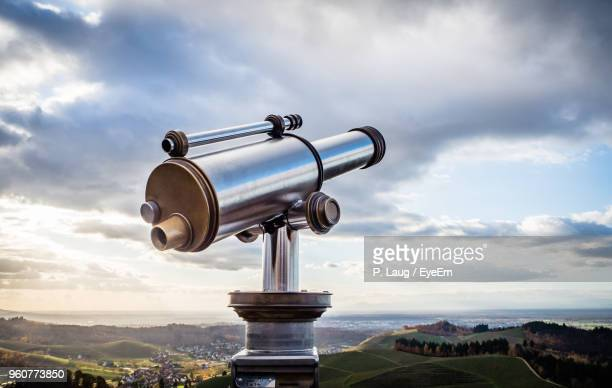 hand-held telescope against sky - telescope stock pictures, royalty-free photos & images
