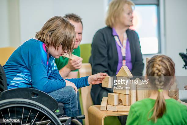 Handicap Girl Playing with Wooden Blocks