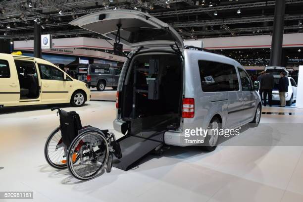 handicap van with ramp on the motor show - disabled access stock photos and pictures