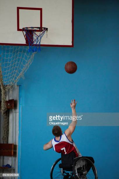 Handicapped athlete shooting hoops