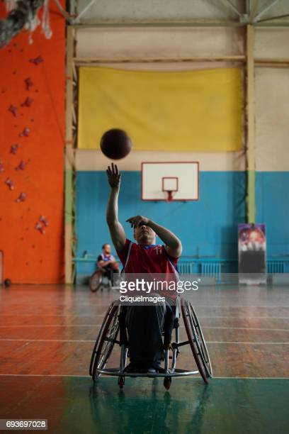 handicapped basketball player shooting ball - cliqueimages stock pictures, royalty-free photos & images