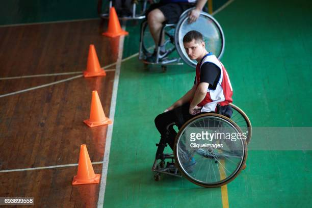 handicapped basketball player waiting for match - cliqueimages stock pictures, royalty-free photos & images