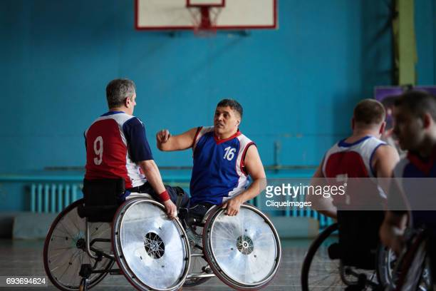 handicapped basketball players discussing match - cliqueimages stock pictures, royalty-free photos & images