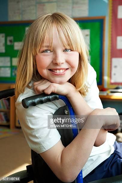Handicapped blond ten year old boy in a wheelchair