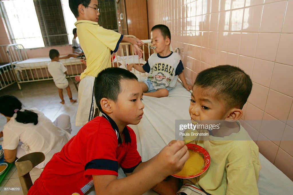 Handicapped children help feed younger patients at the Tu Du Hospital May 2, 2005 in Ho Chi Minh City, Vietnam. Many of the children have been deformed since birth from what may be the effects of the defoliant Agent Orange used in the Vietnam War. On March 10 a U.S. Federal Court in Brooklyn, New York dismissed a law suit on behalf of millions of Vietnamese against the U.S. for its use of the toxic defoliant during the Vietnam War, which contains dioxin. In 1984, seven American chemical companies paid $180 million to settle a suit by U.S veterans affected by Agent Orange. Vietnam pledges to pursue the lawsuit and is taking the case to a US Court of Appeals in June.