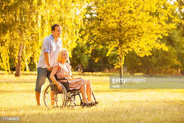 handicapped couple outdoors. - long hair stock pictures, royalty-free photos & images