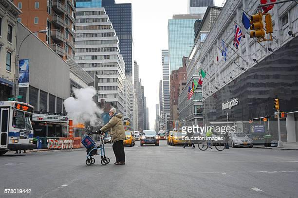 Handicapped Gentleman With Walker Crossing Street