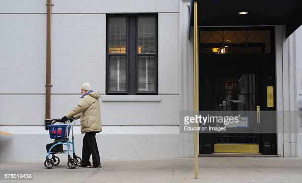 Handicapped Gentleman With Walker Out For Stroll