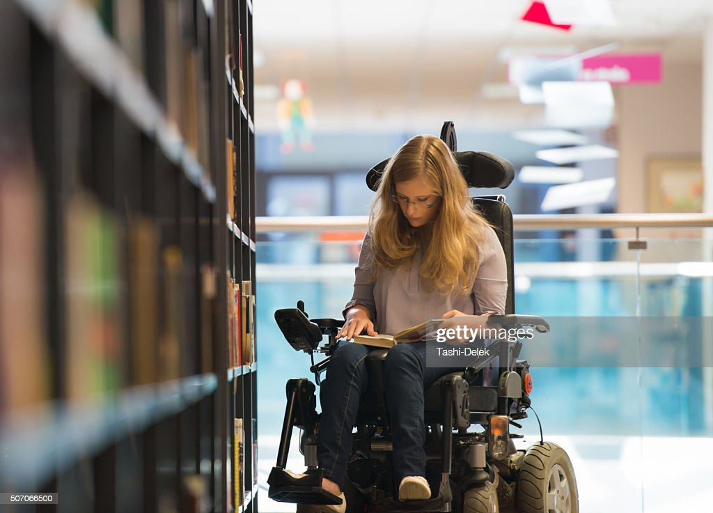 Handicapped Girl In Library : Stock Photo