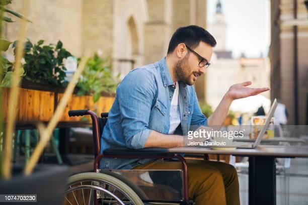 Handicapped man at cafe