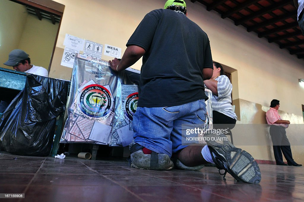 A handicapped man casts his vote at a polling station in Asuncion on April 21, 2013. Voters in Paraguay cast ballots Sunday to choose a new leader and try to turn the page on a political crisis that saw the impeachment of leftist president Fernando Lugo ten months ago. AFP PHOTO/Norberto Duarte
