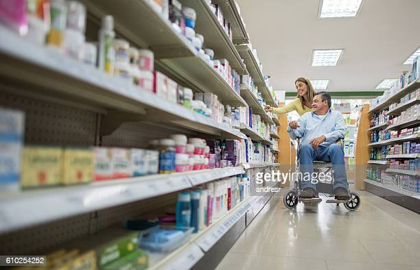 Handicapped man shopping at a drugstore